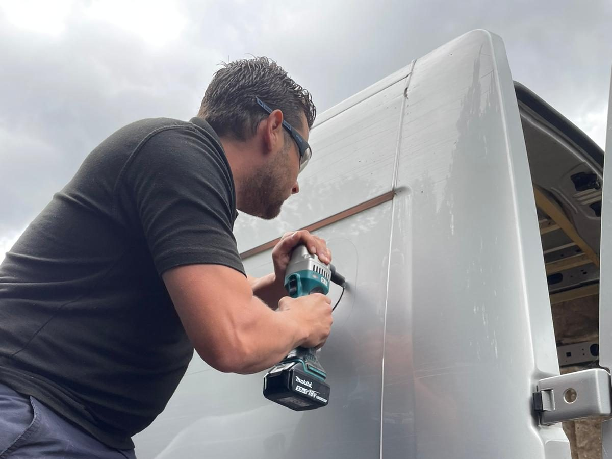 Cutting out a panel for a small window installation 2021